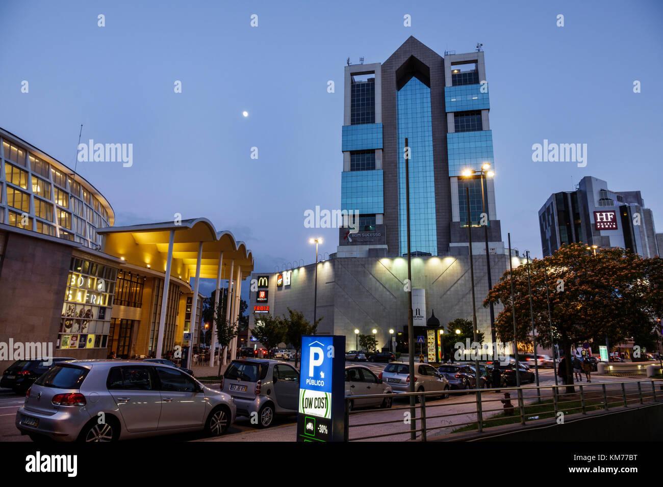 Porto Portugal Mercado do Bom Sucesso exterior Shopping Cidade do Porto building street parking moon dusk - Stock Image