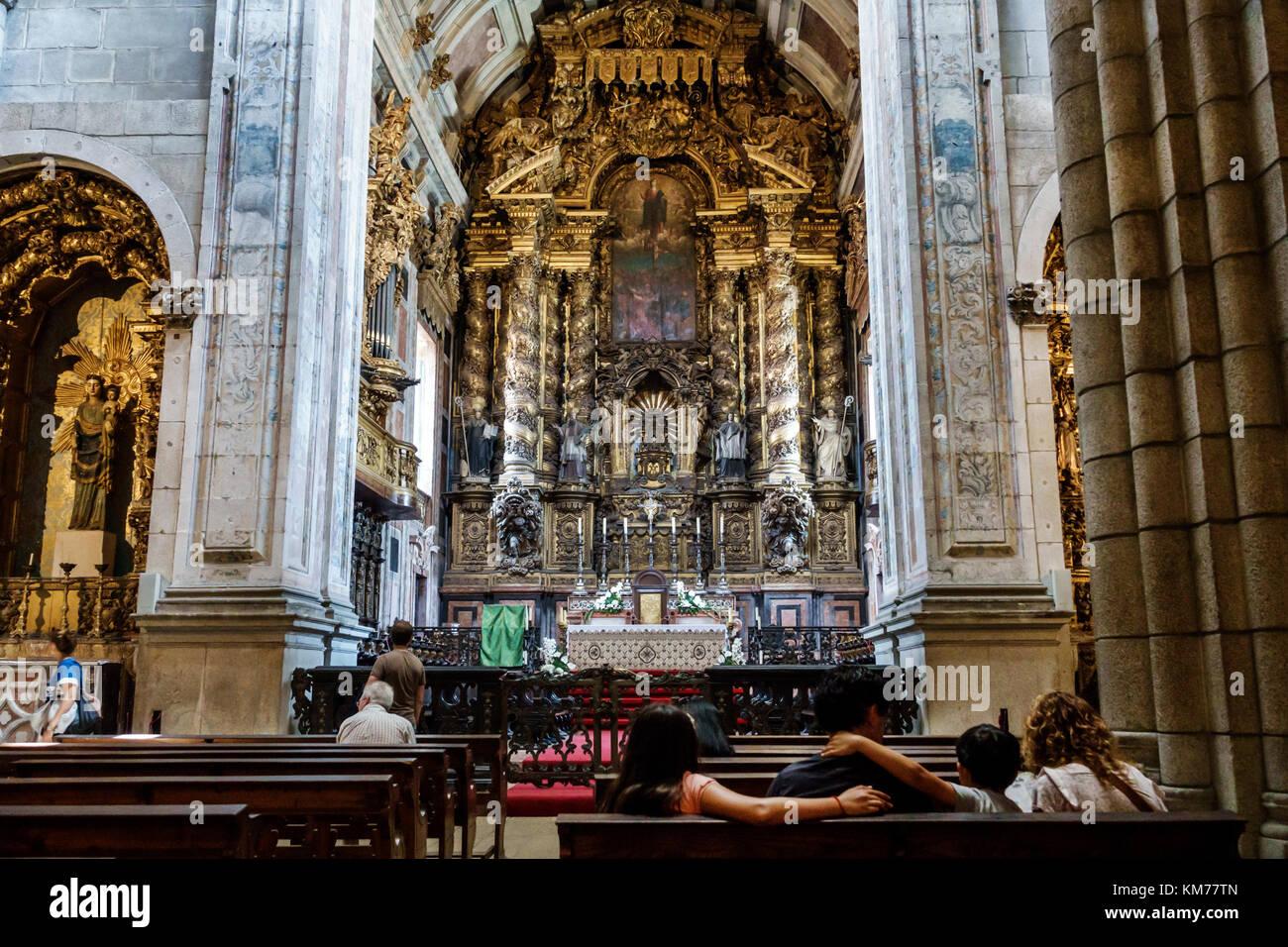 Porto Portugal historic center Se do Porto Porto Cathedral Roman Catholic church interior main altar pews family - Stock Image