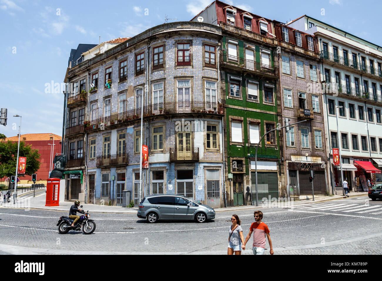 Porto Portugal historic center Calcada de Vandoma residential apartment building intersection car motorcycle pedestrian - Stock Image