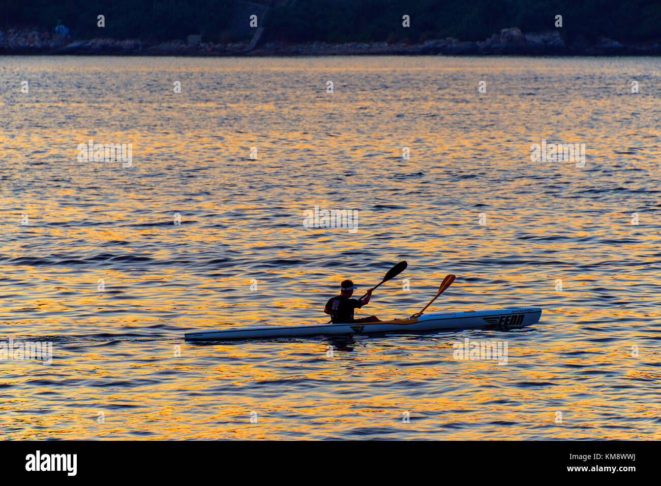 Canoeing at Sunset, Middle Bay, Hong Kong - Stock Image