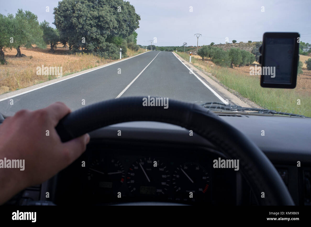 Driving calmly by local road with GPS. View from the inside of the car - Stock Image