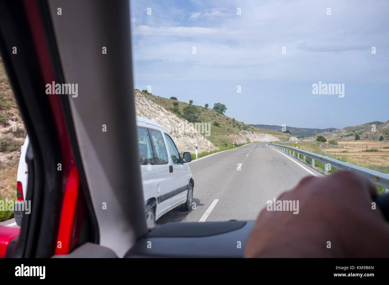 Driver being overtaken at local road. View from the inside of the car - Stock Image