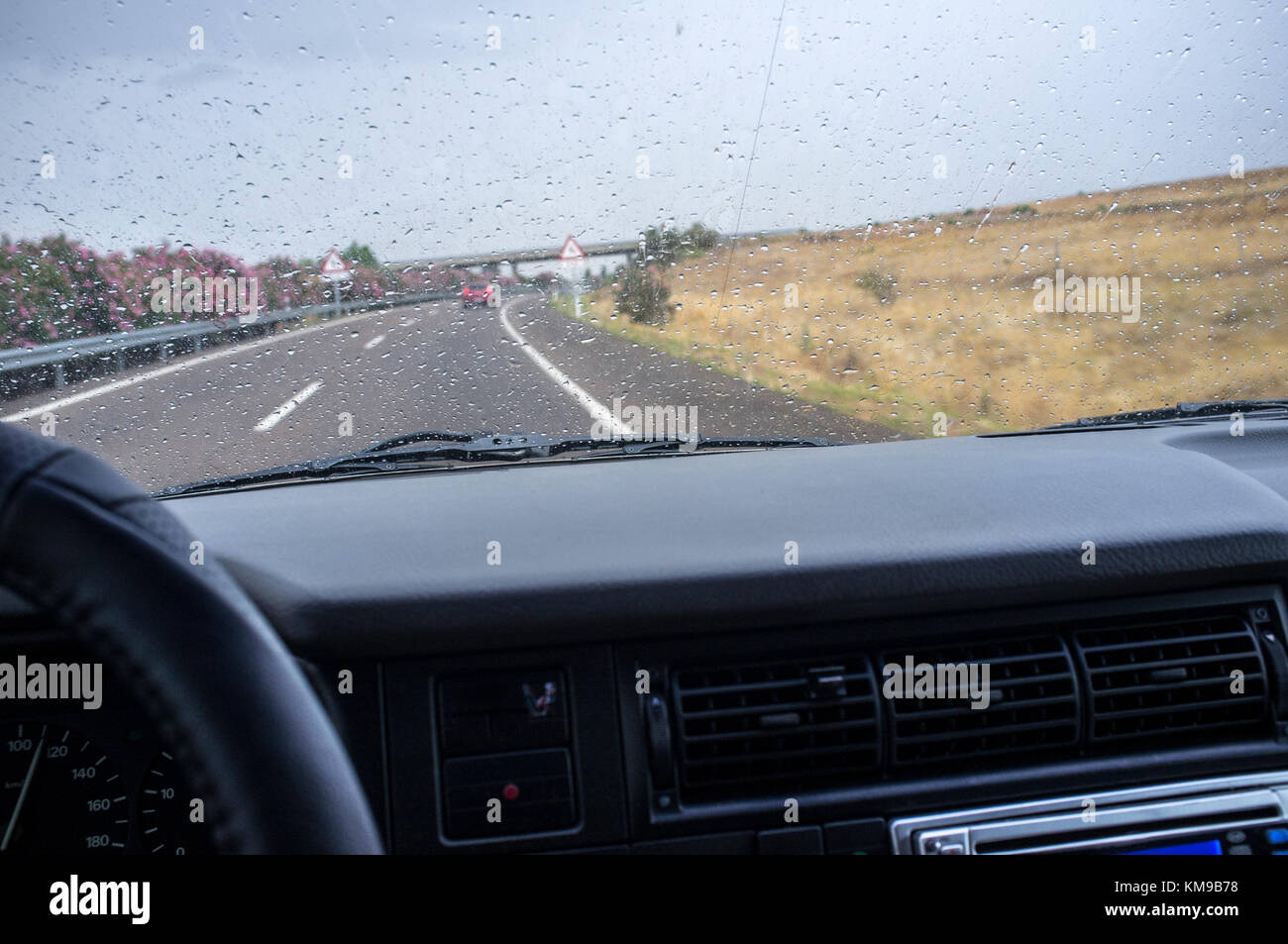 Driving on a highway in the rain. View from the inside of the car - Stock Image