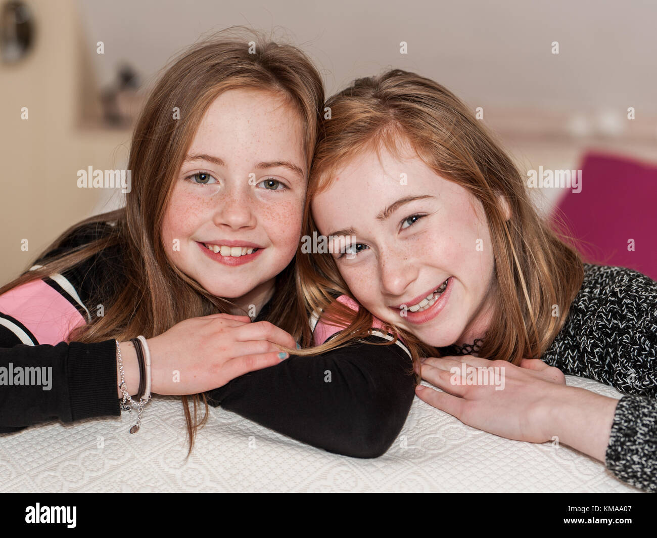 two-smiling-young-girls-posing-for-the-c