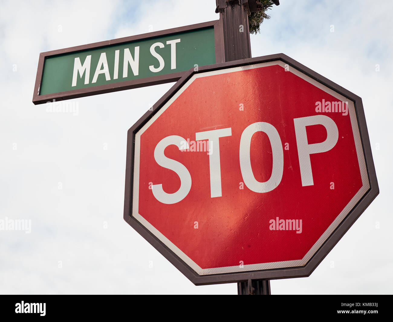 Main Street USA, street sign at a stop intersection, in a small town in rural Alabama, USA. - Stock Image