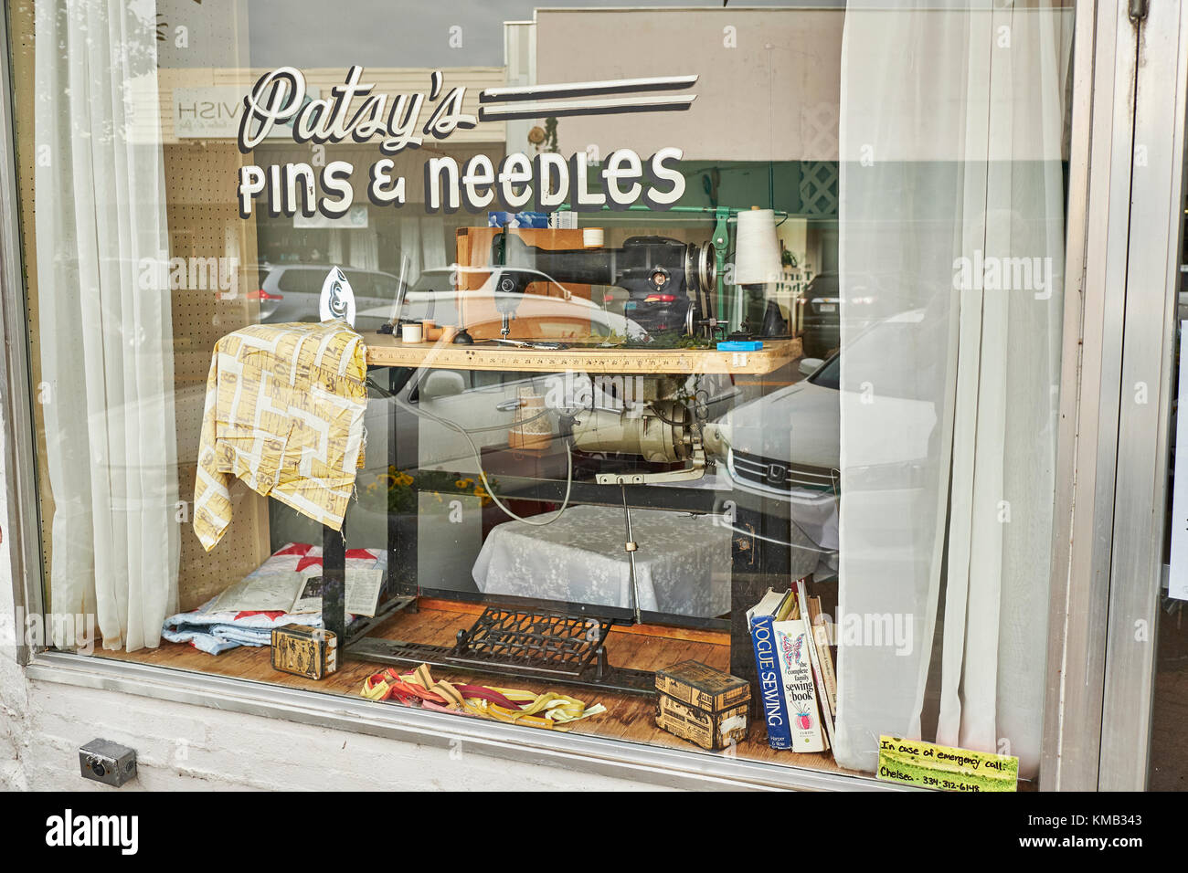Vintage style sewing shop window in small rural town in the southern USA, Prattville Alabama United States. - Stock Image