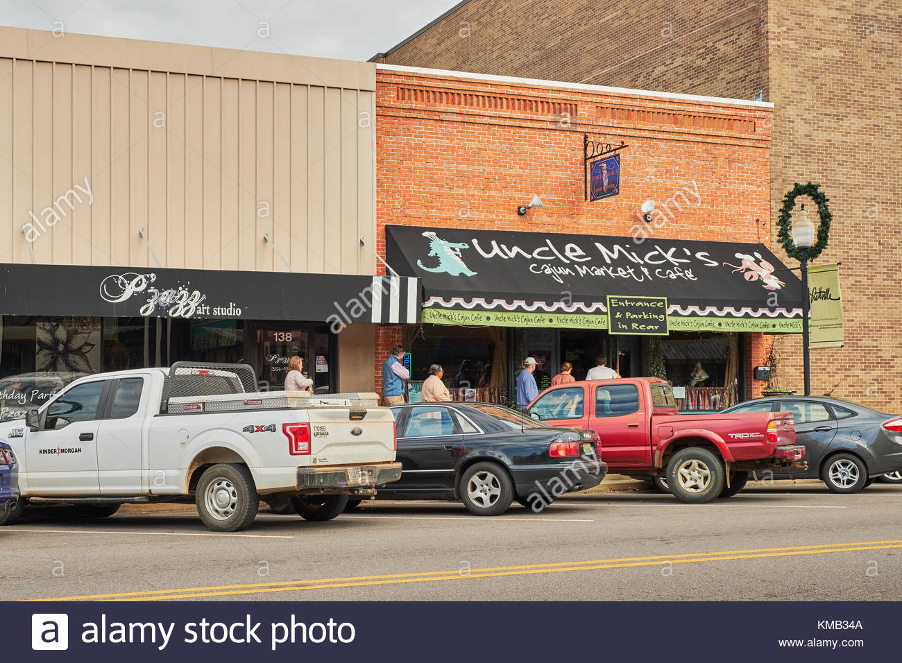 People lined up or queuing to enter a small cafe and market in Clanton Alabama, USA, a small rural town in Alabama. - Stock Image