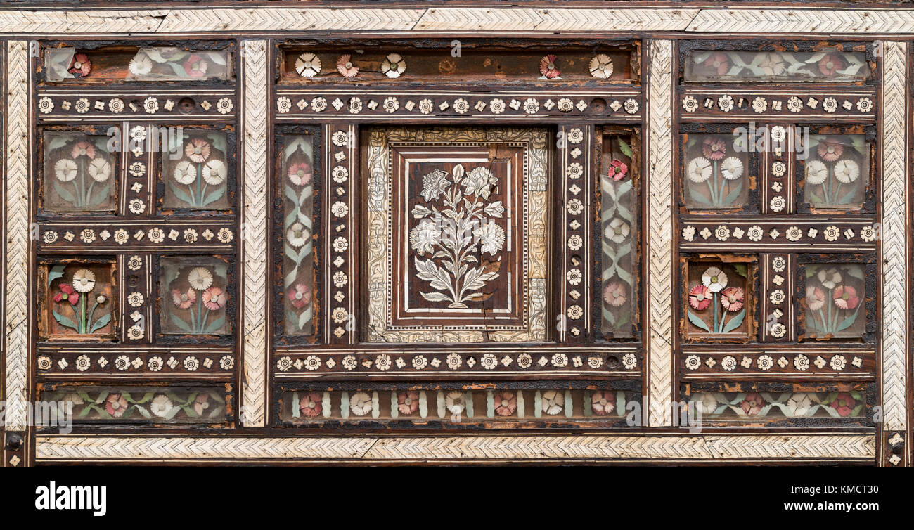 Closeup of wooden seamless floral pattern ornaments on old wooden chair - Stock Image