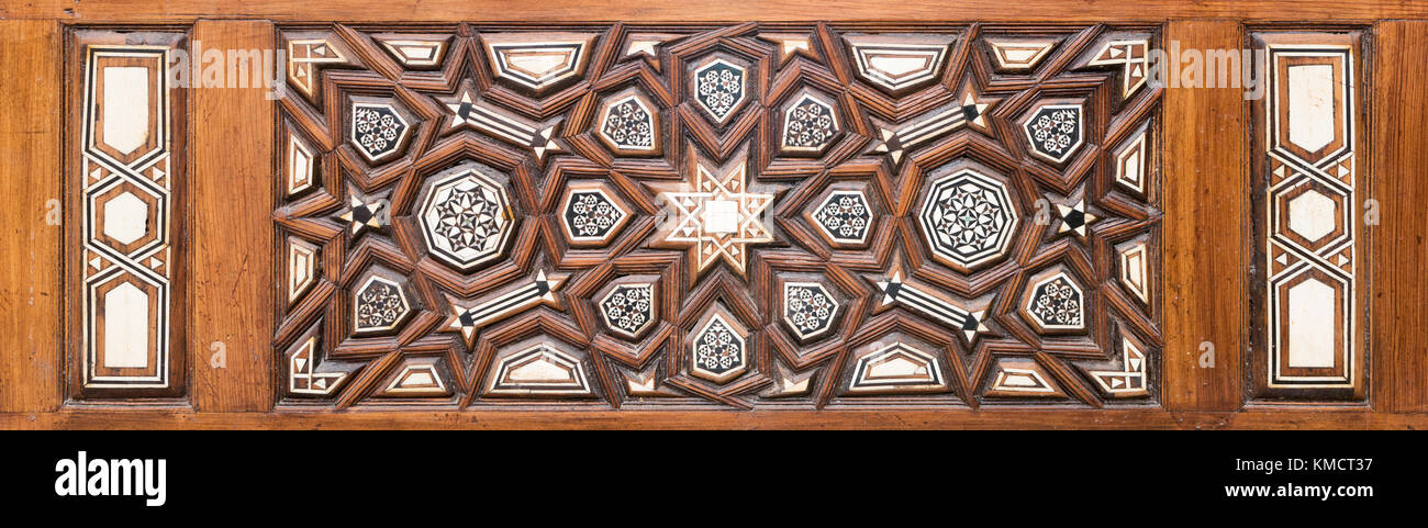 Closeup of arabesque ornaments of an old aged decorated wooden door, Old Cairo, Egypt - Stock Image