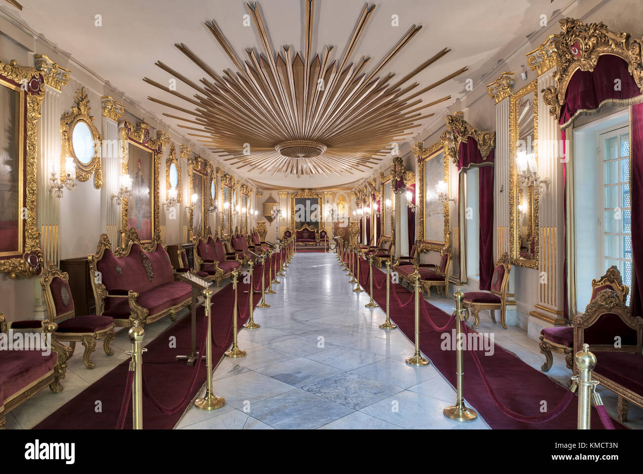 Throne Hall at Manial Palace of Prince Mohammed Ali Tewfik with gold plated red armchairs, antique floor lamps and - Stock Image