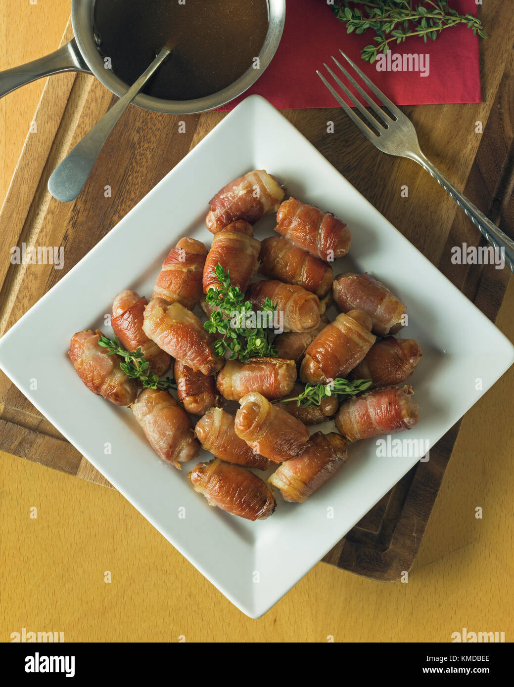 Pigs in blankets.Sausage and bacon rolls. UK Food - Stock Image
