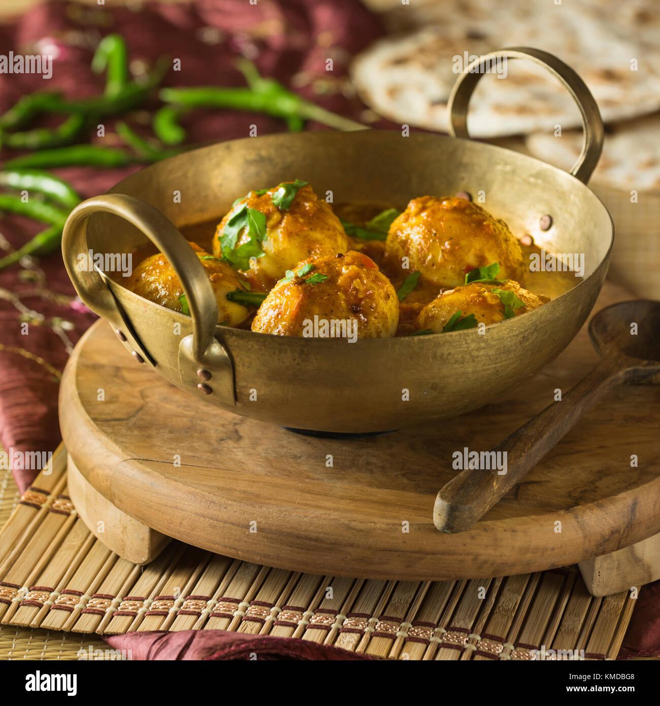 Eggs masala. Egg curry. India Food - Stock Image