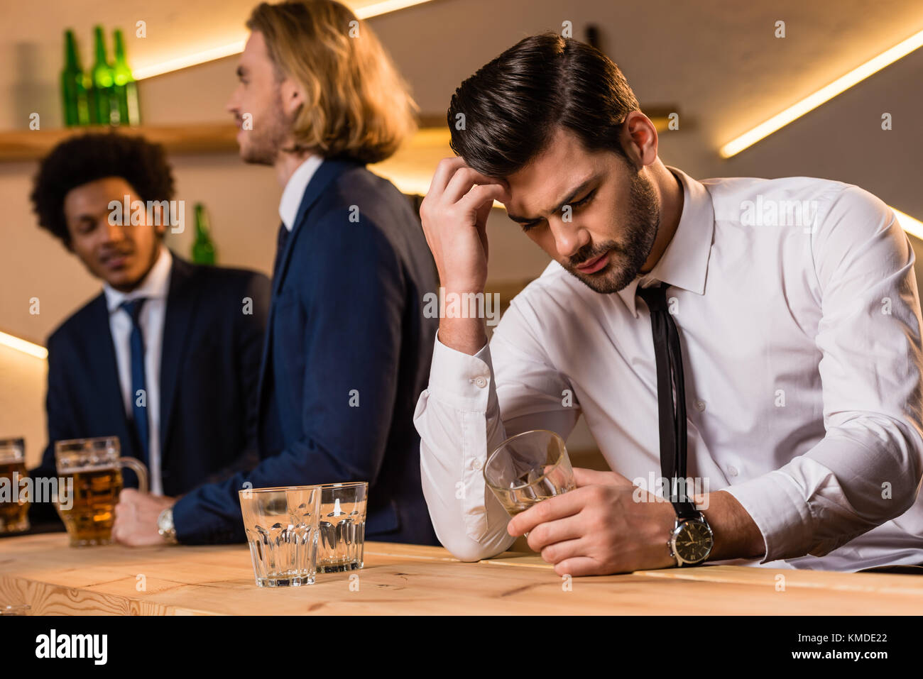 drunk businessman in bar  - Stock Image