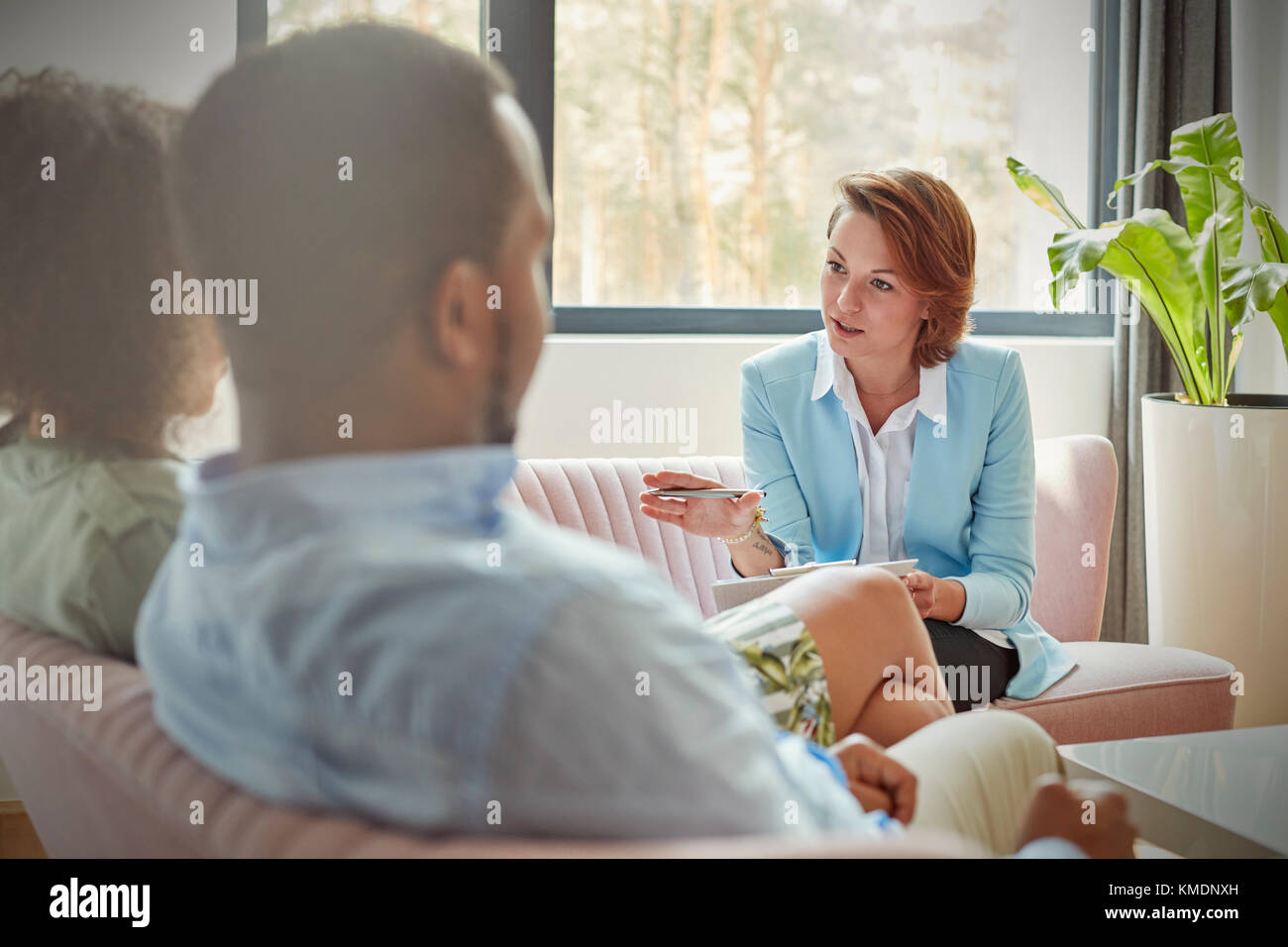 Therapist talking to couple in couples therapy session - Stock Image