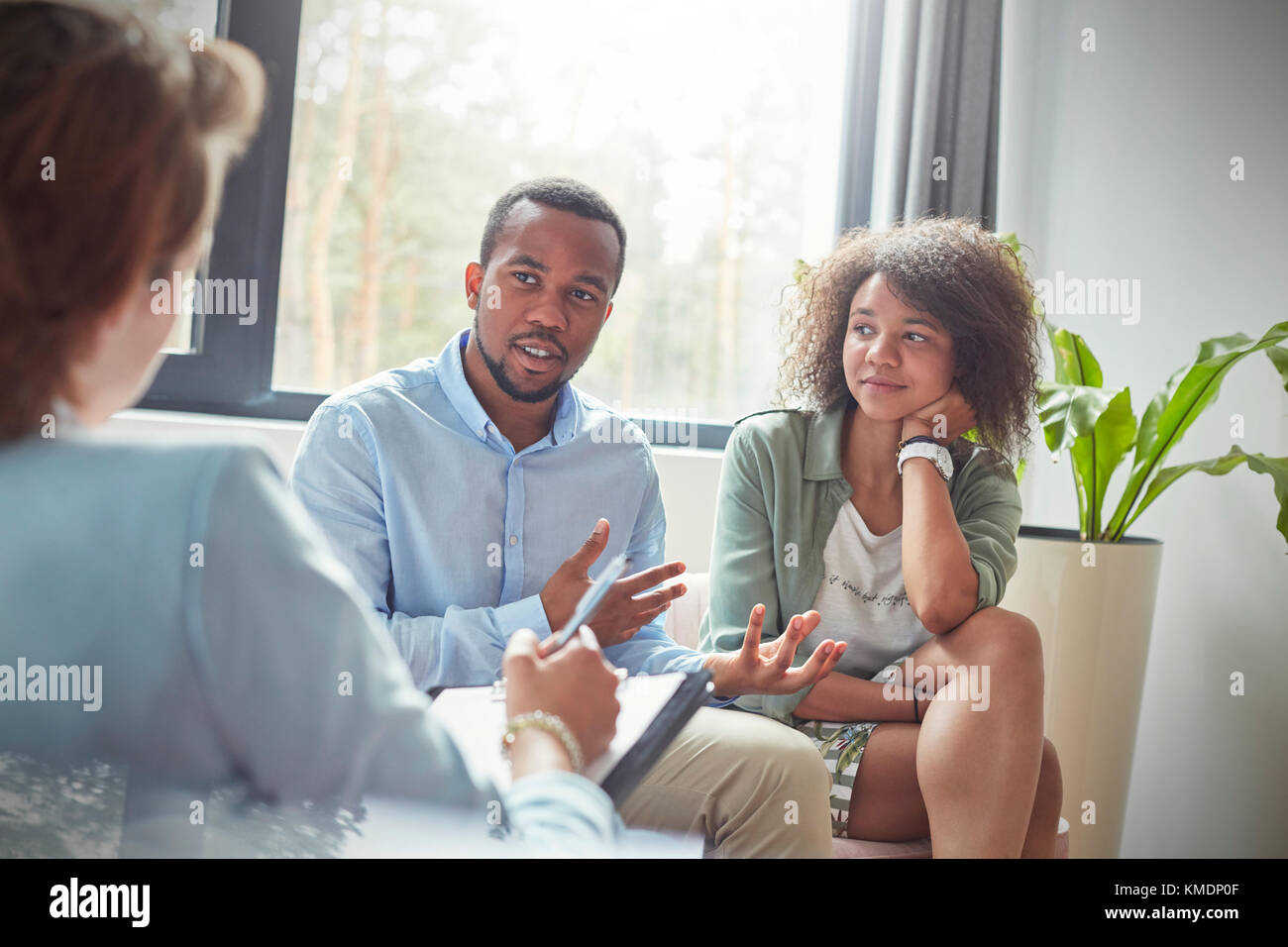 Couple talking to therapist in couples therapy session - Stock Image