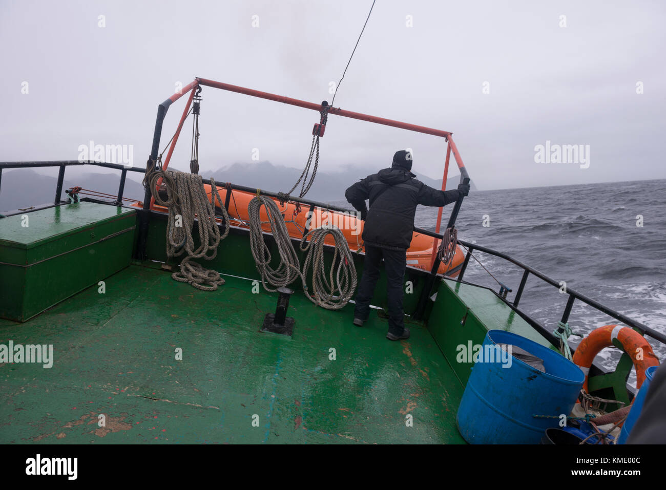 Boat navigating through the Straits of Magellan in heavy seas - Stock Image
