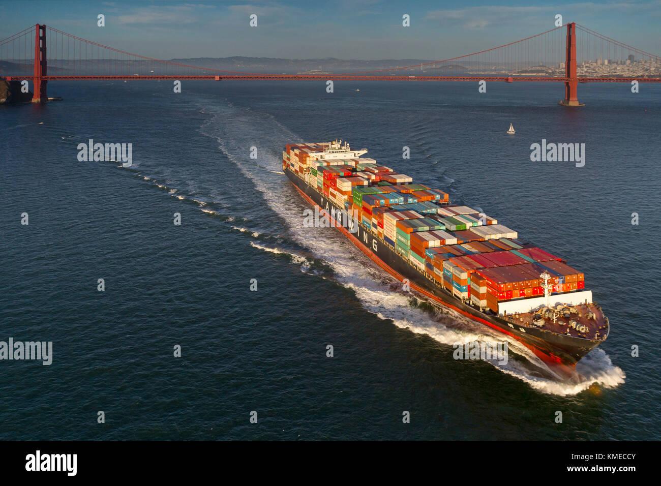 Freighter sailing against Golden Gate Bridge,San Francisco,California,USA - Stock Image