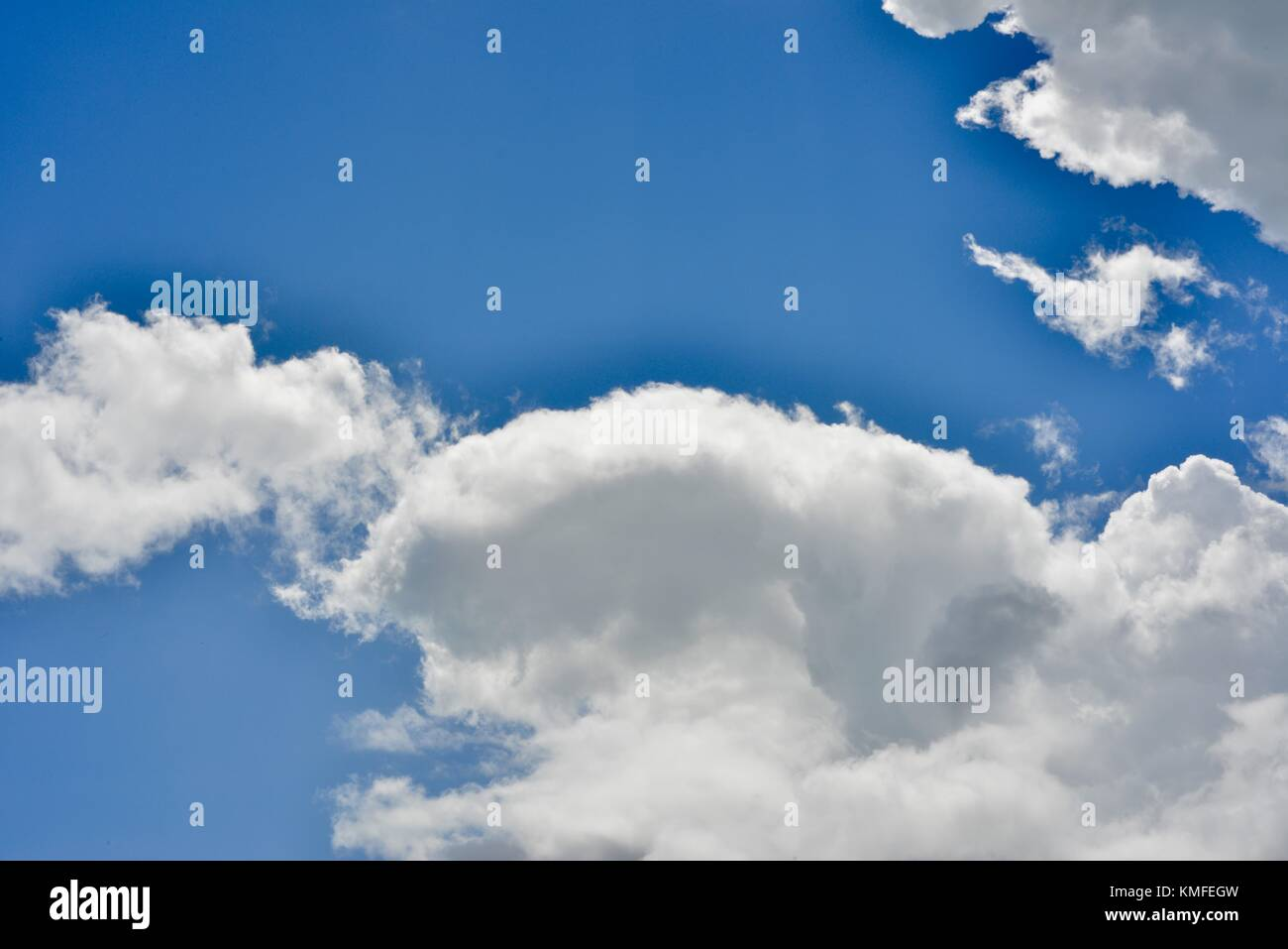 Blue sky contrasting with silver grey clouds in a skyscape, Townsville, Queensland, Australia - Stock Image