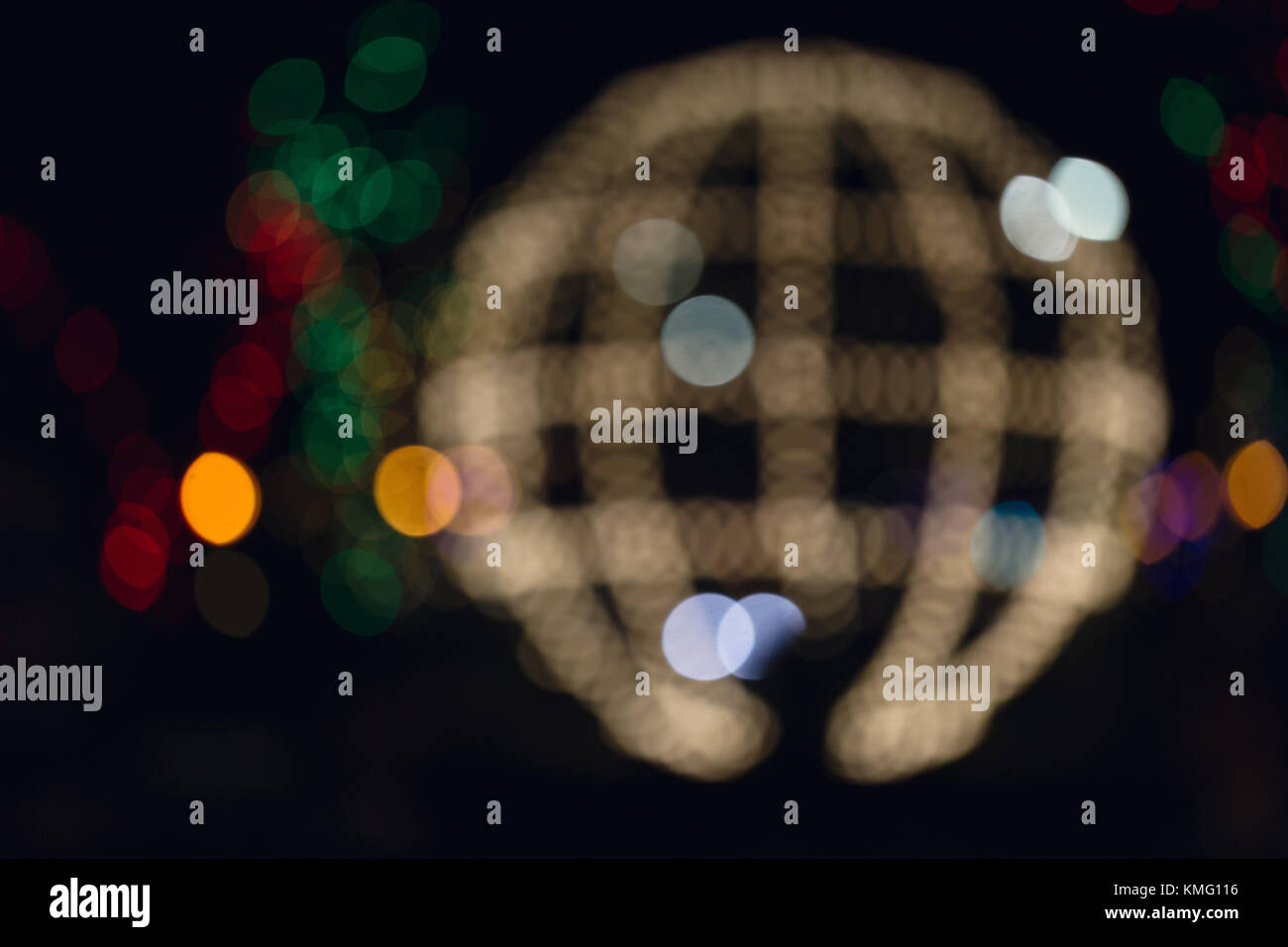 Abstract illuminated christmas sphere with various color background. - Stock Image