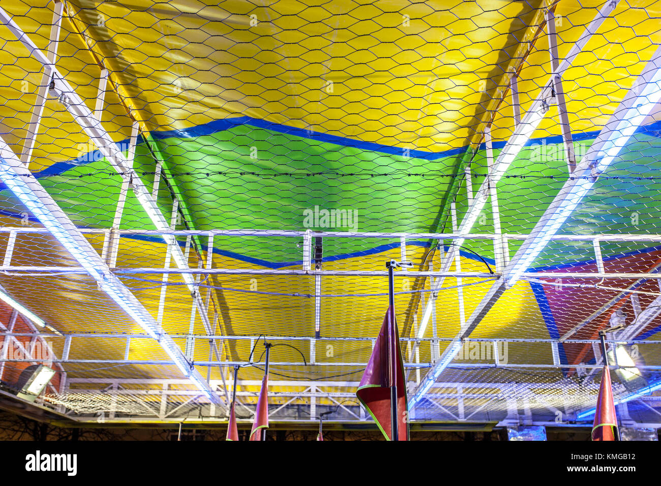 Bumper cars ceiling attraction. Metallic net detail - Stock Image