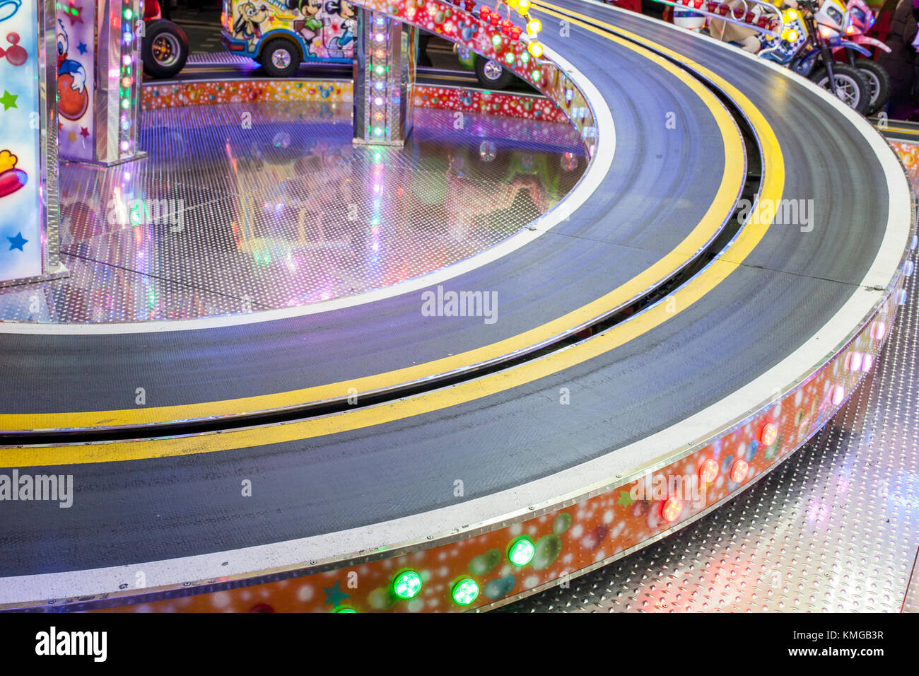 Fair ground ride childrens cars track. Funfair concept - Stock Image