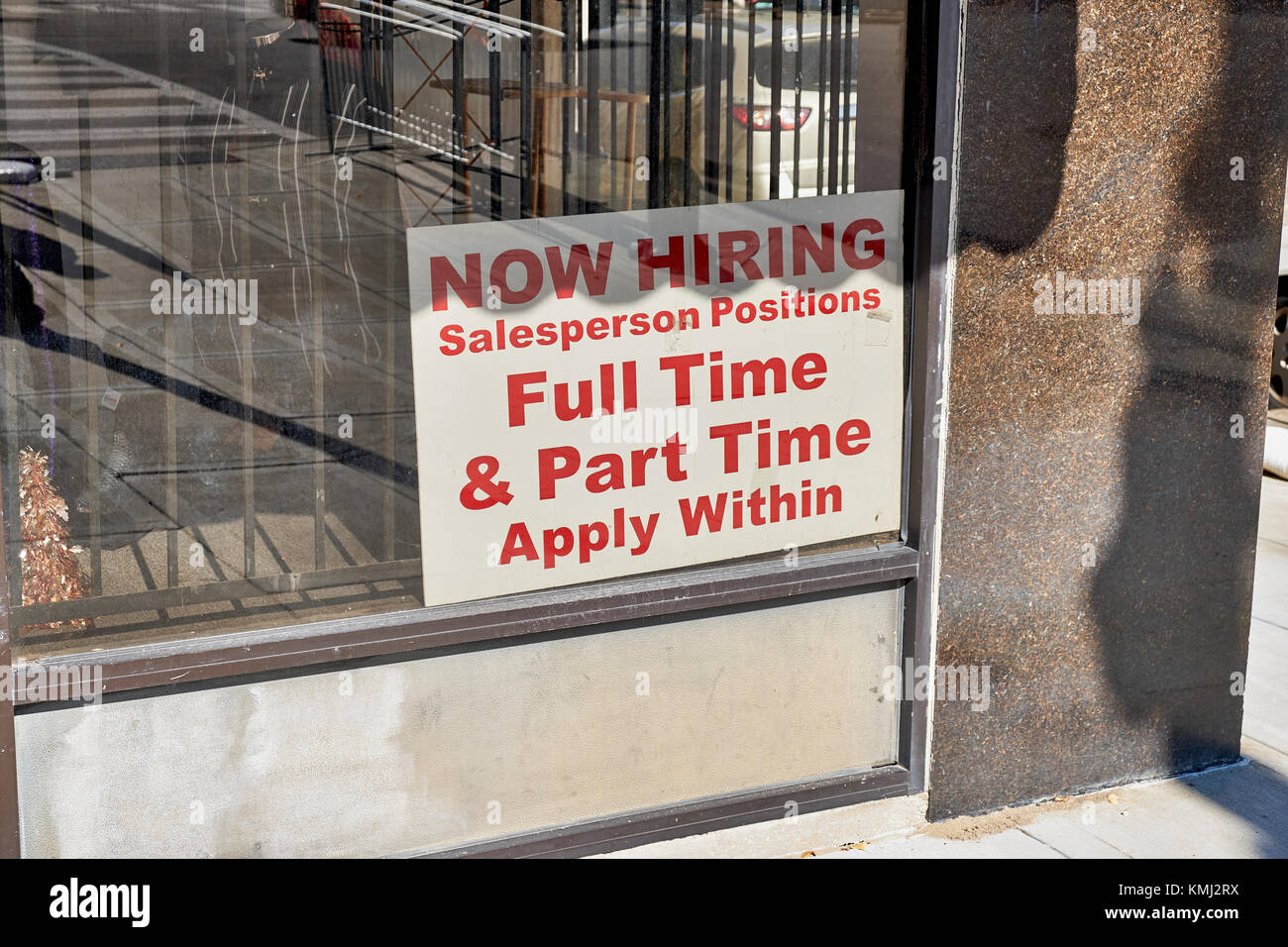 Help wanted sign in a small business window in downtown Montgomery Alabama, USA. - Stock Image