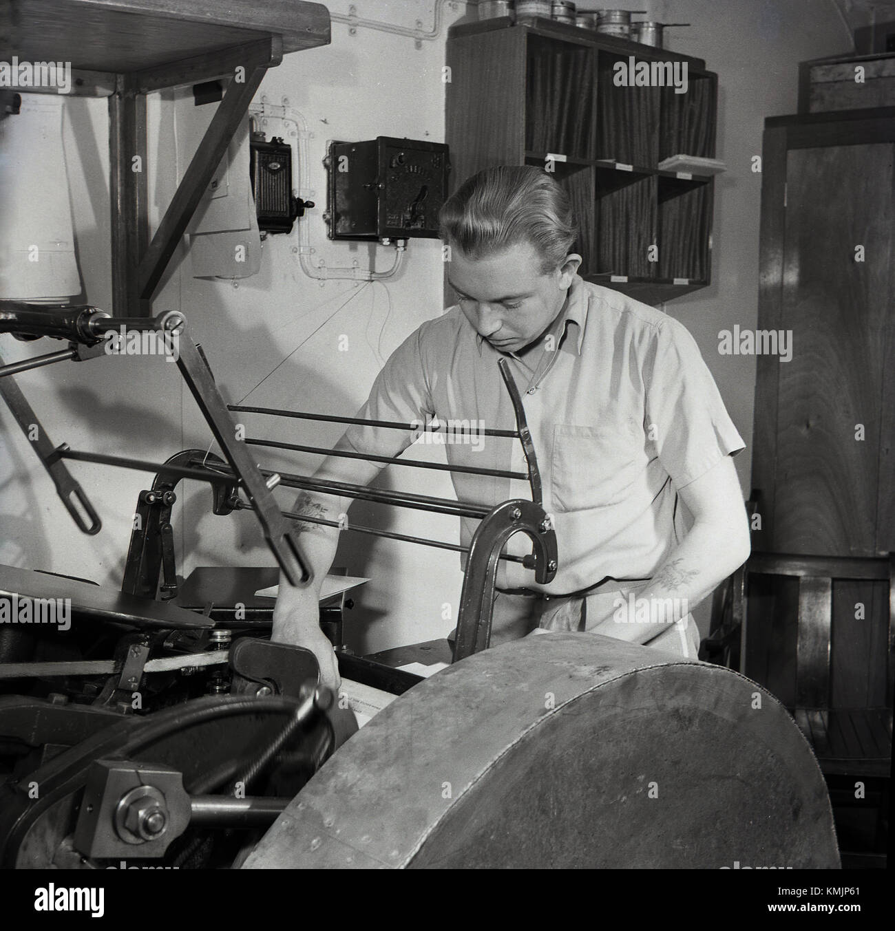 1950s, historical, Working in the print room on a Union-Castle mailship. These mailships ran from Britain to South - Stock Image