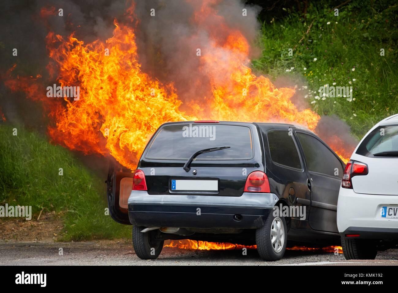 Burning car - Stock Image