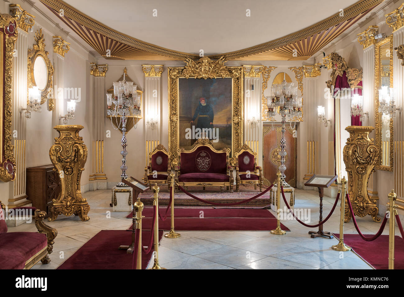 Cairo, Egypt - December 2, 2017: Throne Hall at Manial Palace of Prince Mohammed Ali Tewfik with gold plated red - Stock Image
