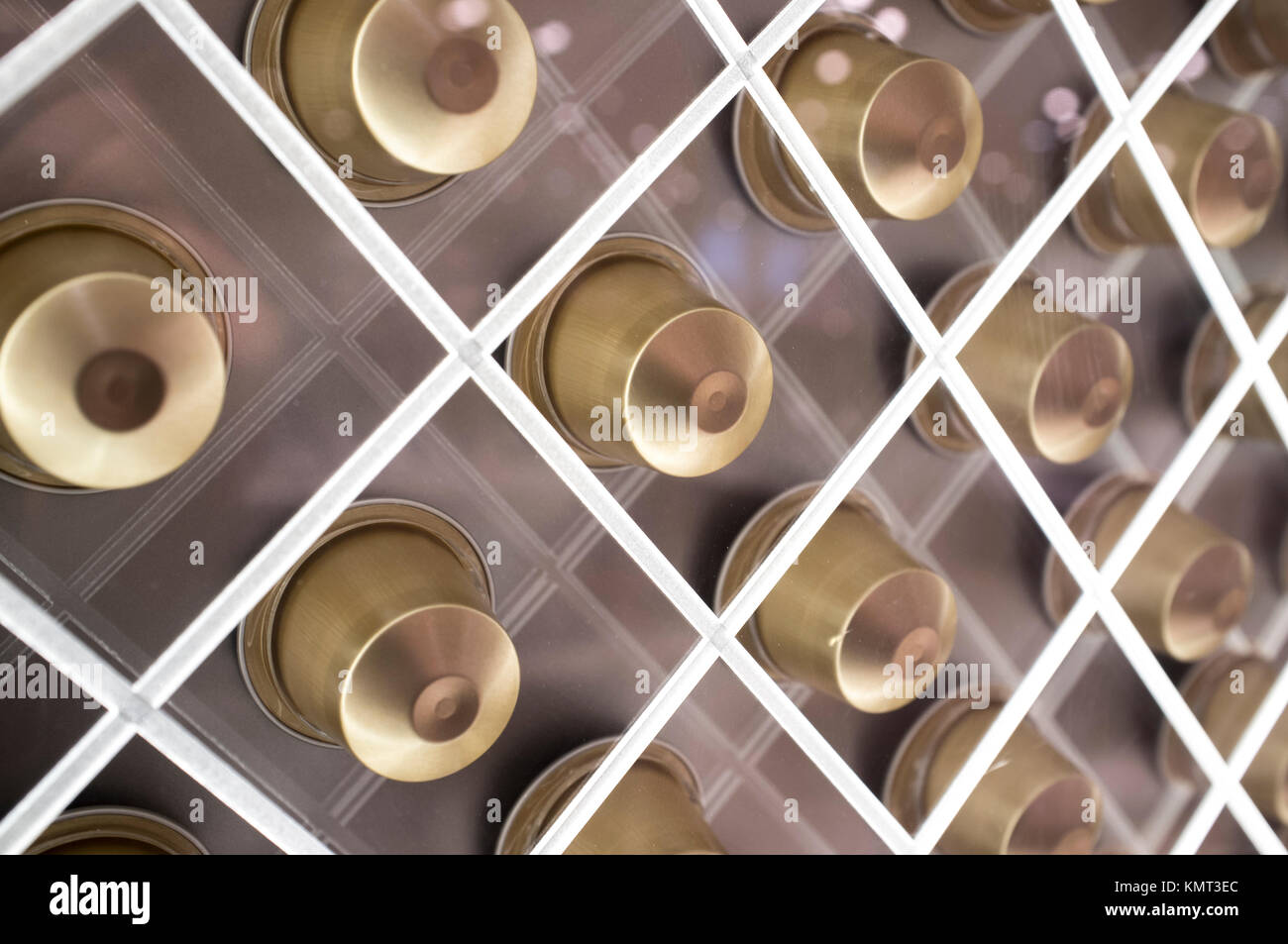 Single-serve coffee containers or coffee capsules. Net shaped sales stand. Closeup - Stock Image
