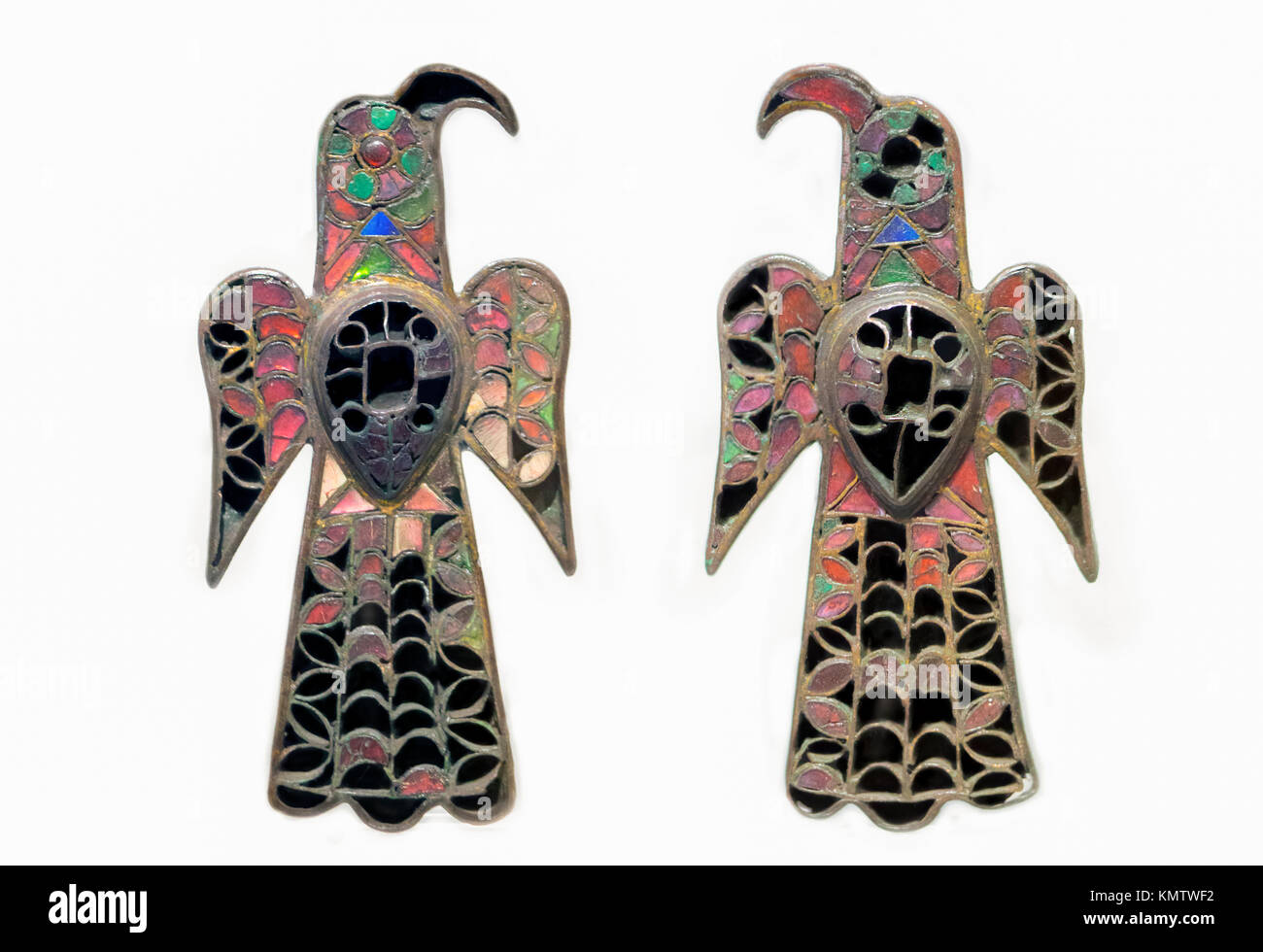 Eagle-shaped brooches belonging to Visigoth Kingdom. Golden Bronze and colorful glass - Stock Image