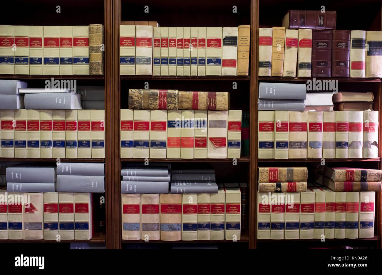 Bookshelf plenty of old legal books. Library law background - Stock Image