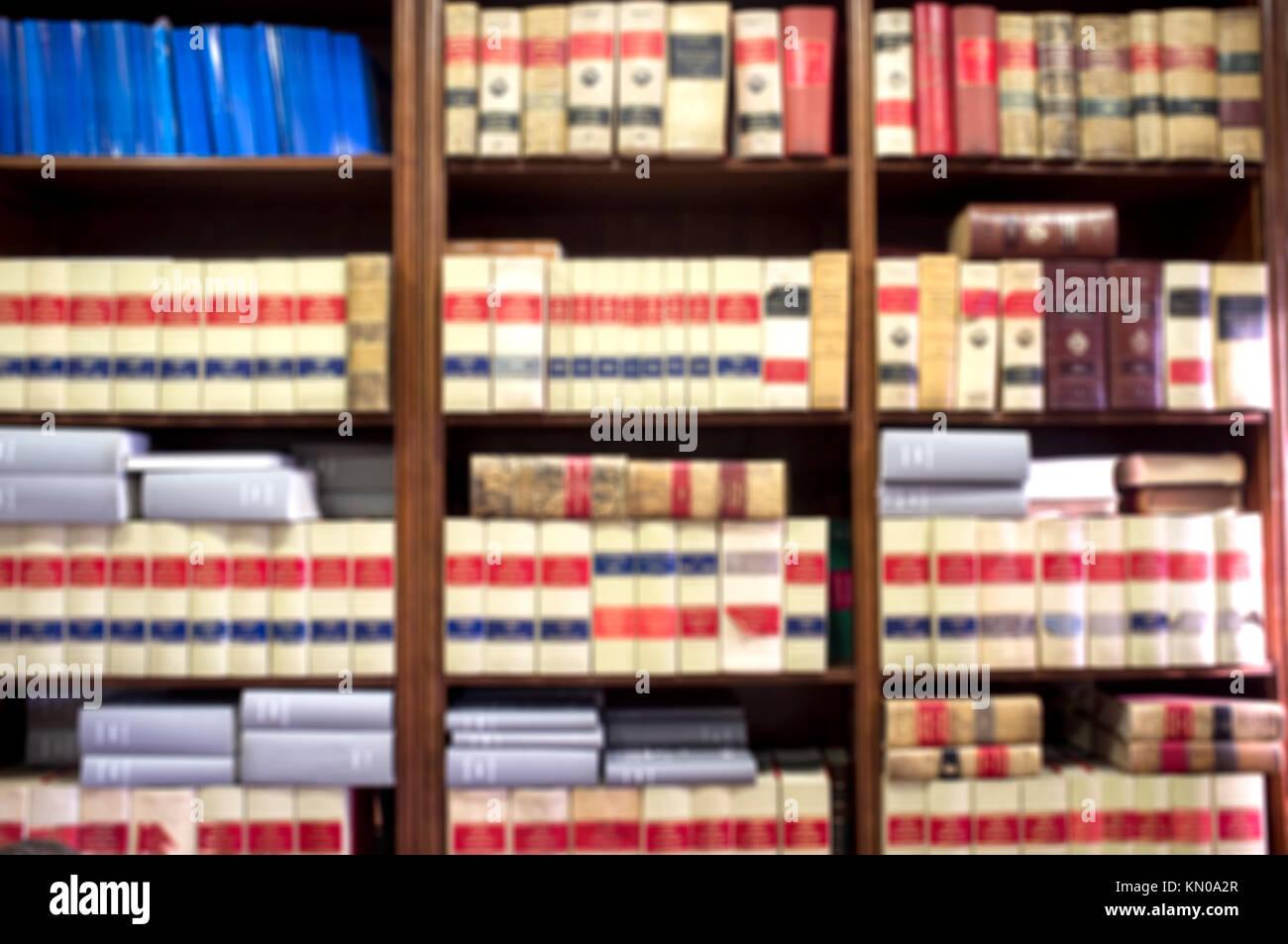 Bookshelf plenty of old legal books. Blurred background - Stock Image