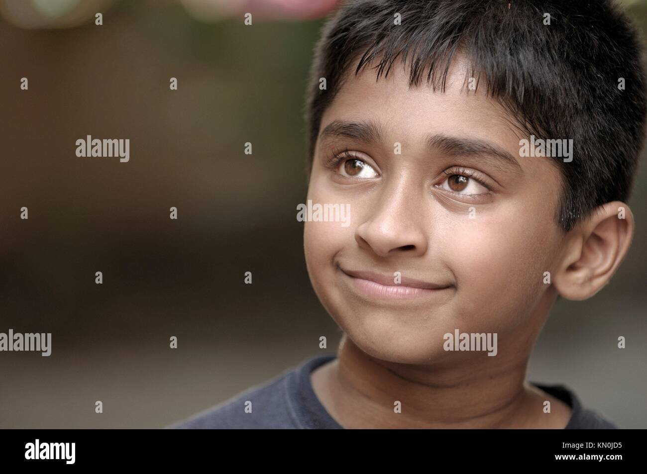 Young Indian boy day dreaming Stock Photo