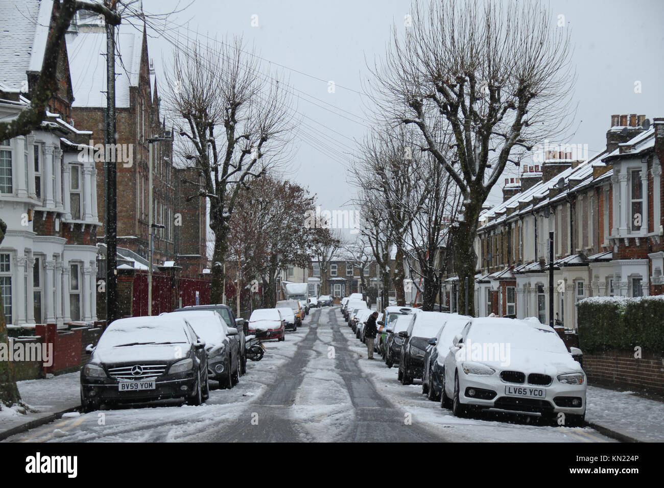 LONDON, UK - DECEMBER 10: Sandringham Road in East London covered with snow from a shower that began at around 3 - Stock Image
