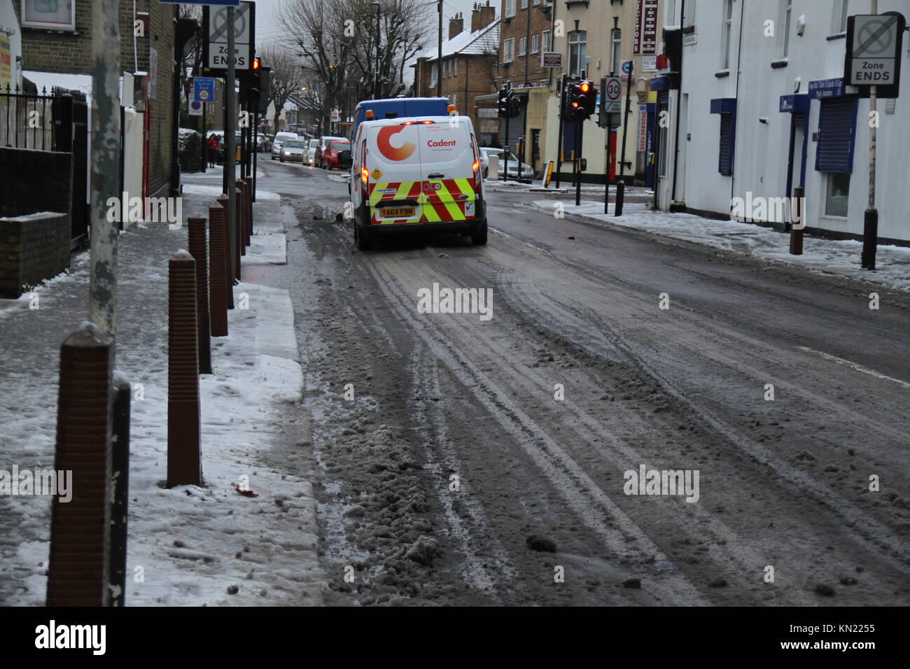 LONDON, UK - DECEMBER 10: Black ice is seen on a road in East London following snowfall from a shower that began - Stock Image