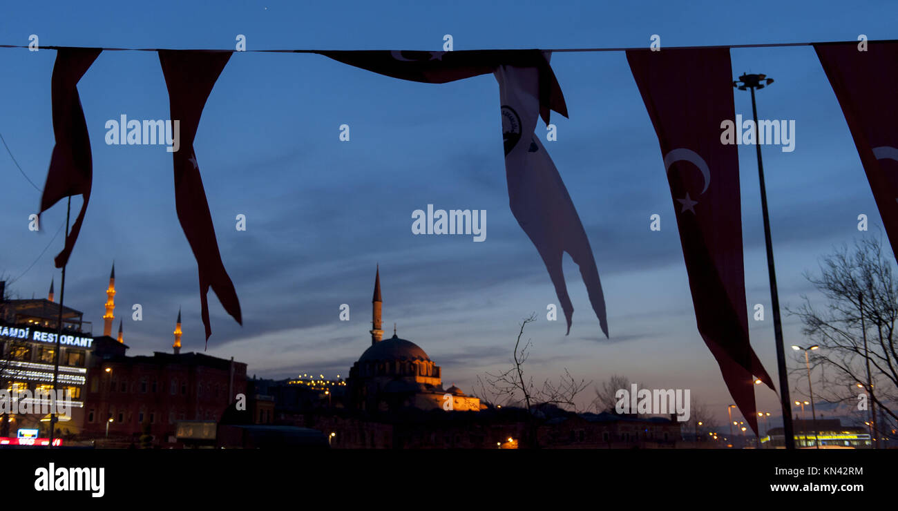Flags with Rustem Pasha Mosque in the background, Istanbul, Turkey. - Stock Image