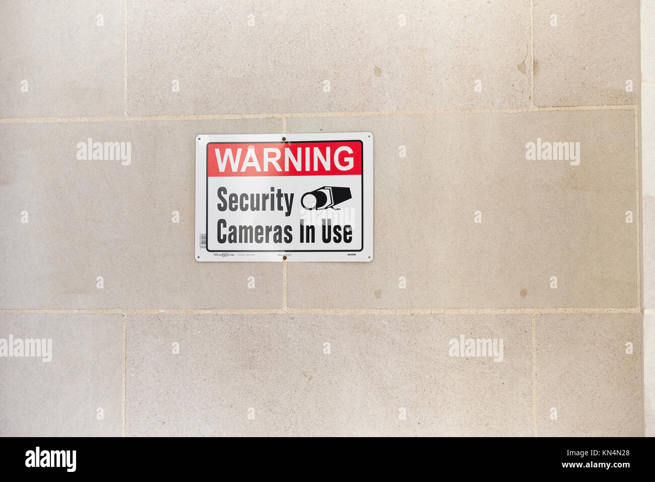 Warning sign at entrance to a United States bank advising security camera and cameras are in use for surveillance - Stock Image