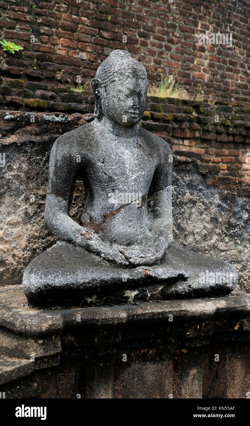 Pabula Vihara temple, UNESCO World Heritage Site, the ancient city of Polonnaruwa, Sri Lanka, Asia seated Buddha - Stock Image