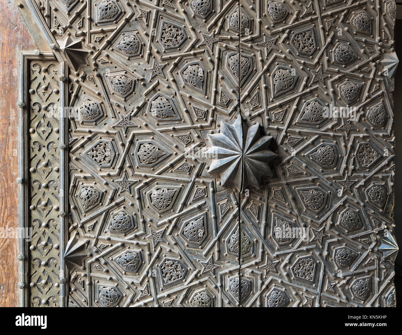 Ornaments of the bronze-plate ornate main gate of Manial Palace of Prince Mohammed Ali Tewfik, Cairo, Egypt - Stock Image