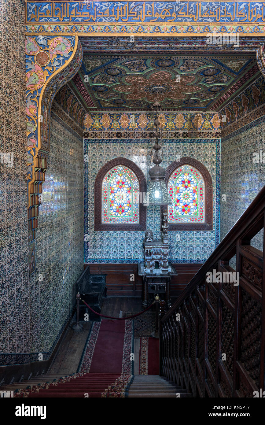 Cairo, Egypt - December 2 2017: Wooden staircase, decorated wooden balustrade, Turkish ceramic tiles wall, ornate - Stock Image