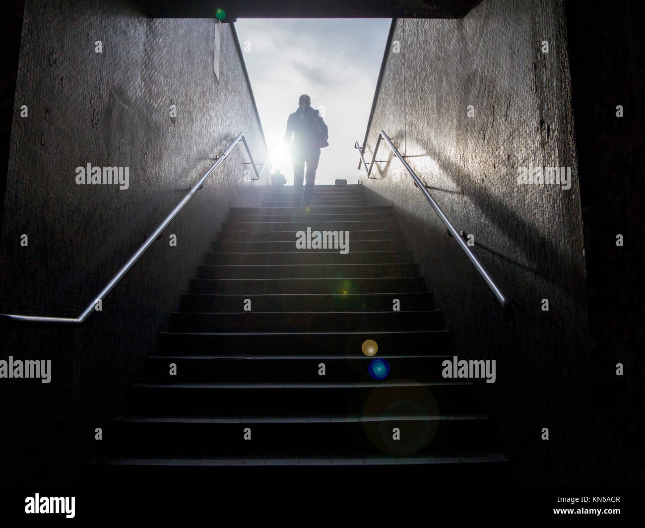 Ascending a staircase from under ground - Stock Image