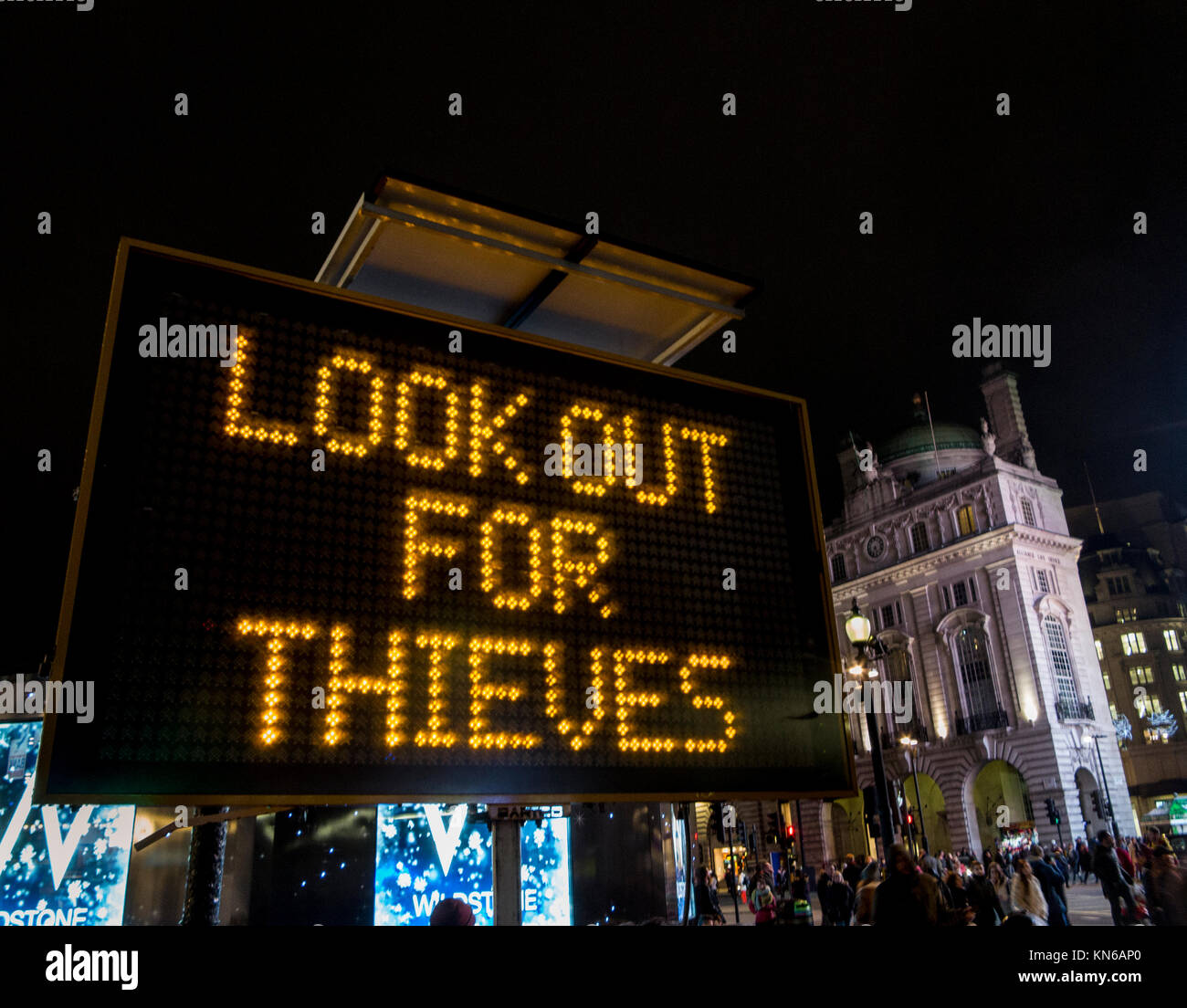 Police sign at Piccadilly Circus warning of thieves in the area as well as to Enjoy your Xmas Tipple but Know Your - Stock Image