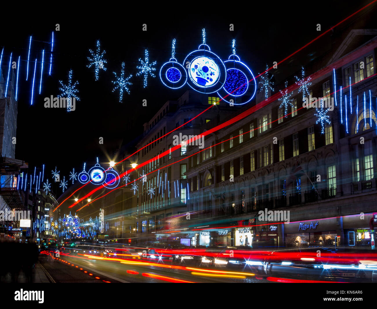 Light trails on The Strand in London at Christmas time - Stock Image