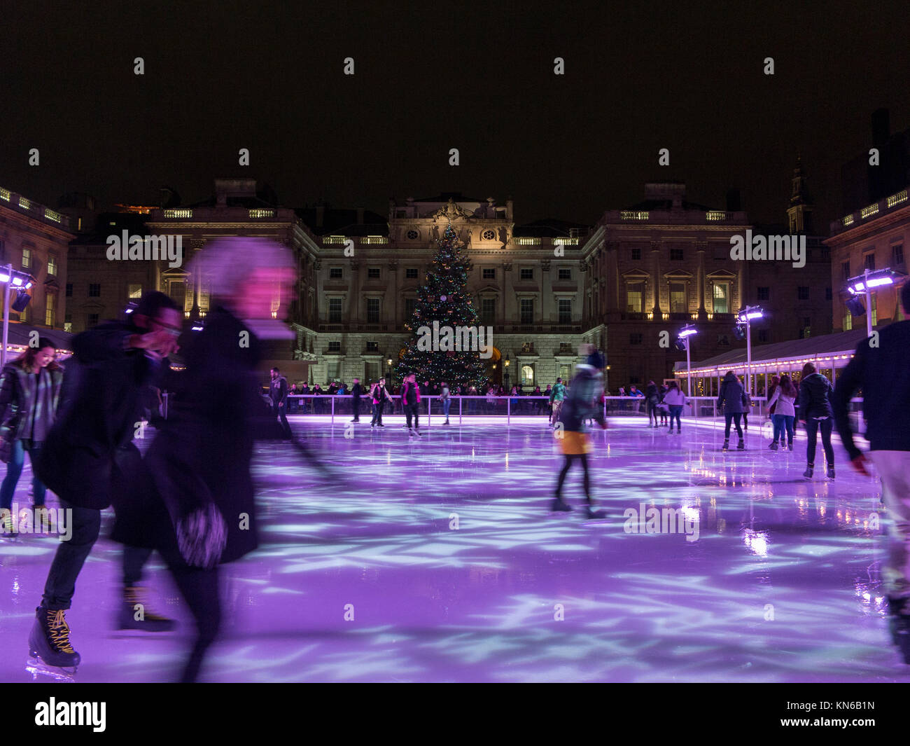 Skaters enjoying the ice rink at Christmas time at Somerset House - Stock Image
