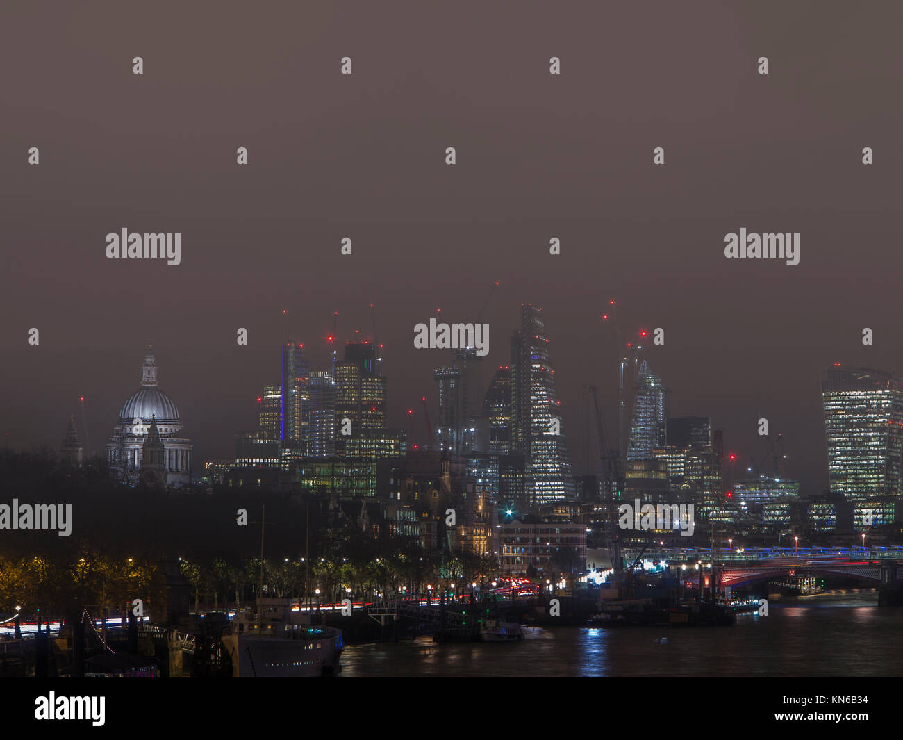 The City of London at night on a foggy, smoggy evening - Stock Image
