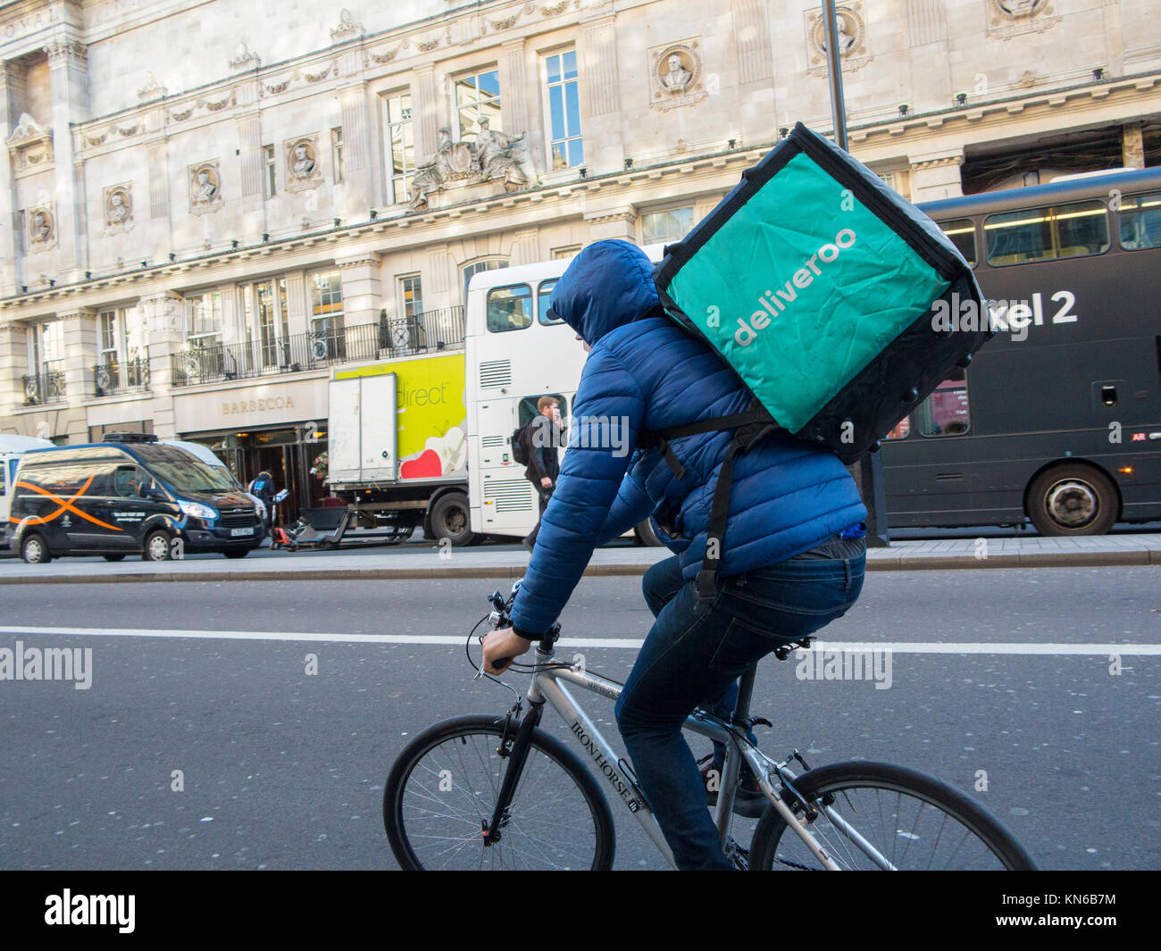 A Deliveroo cyclist on Piccadilly in London - Stock Image