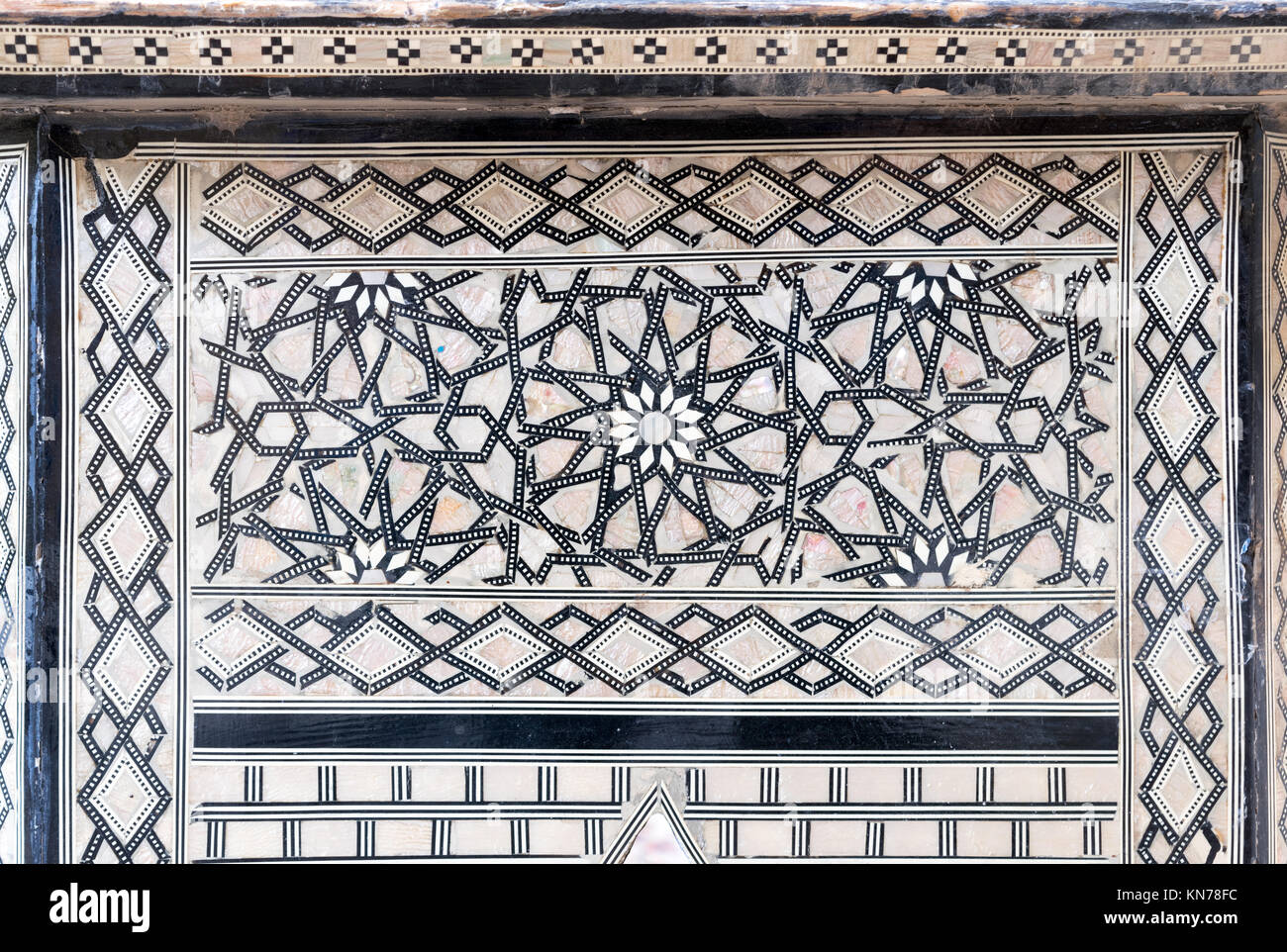 Closeup of arabesque seamless pattern on an ancient old wooden tea table - Stock Image