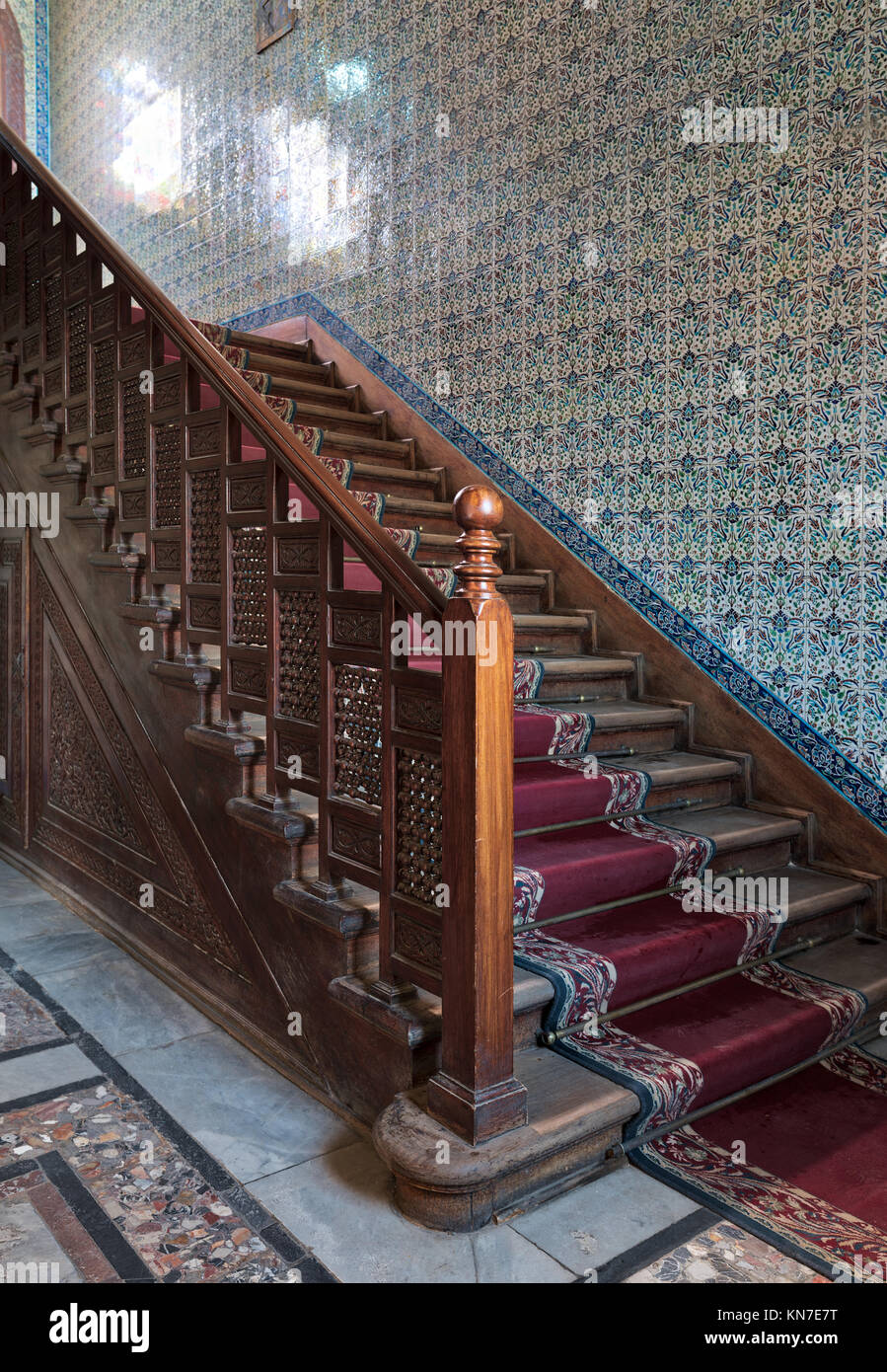 Cairo, Egypt - December 2 2017: Wooden staircase with ornate red carpet, decorated wooden balustrade and Turkish - Stock Image