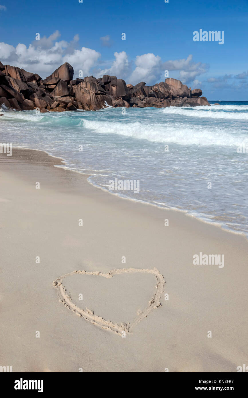 Heart written in sand,  Grand Anse beach ,  East Coast,  La Digue, Seychelles, Indian Ocean, Africa - Stock Image